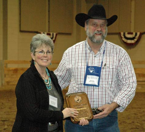Marsha receiving her award from MHC President, Mike Foote.
