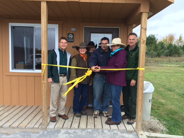 Ribbon cutting ceremony. SHTRA officially donates cabin to DNR.